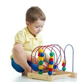 Adorable child playing with toy. Kid having fun with colorful toy on white. royalty free stock photos