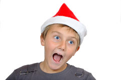 Adorable child with Santa Hat Stock Images