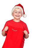 Adorable child with Santa Hat looking in sack Royalty Free Stock Images