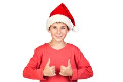 Adorable child with Santa Hat saying Ok Royalty Free Stock Photos