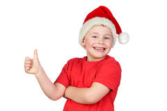 Adorable child with Santa Hat saying Ok Royalty Free Stock Image