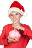 Adorable Child Saving With Santa Hat Royalty Free Stock Photo