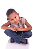 Adorable child sitting Royalty Free Stock Image