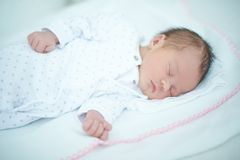 Adorable Child Sleeping on White Blanket Royalty Free Stock Images