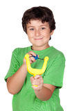 Adorable child with a slingshot Royalty Free Stock Photos