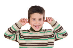 Adorable child stoppering his ears Royalty Free Stock Photography