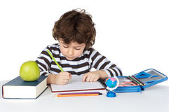 Adorable child studying. A over white background Royalty Free Stock Photos