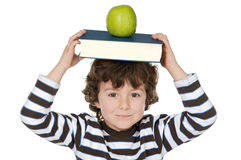 Adorable child studying. With books and apple in the head a over white background Stock Image
