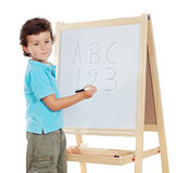 Adorable child studying Stock Photography