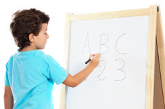 Adorable child studying Royalty Free Stock Images