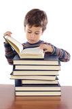 Adorable child studying. A over white background Stock Photo