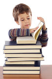 Adorable child studying. A over white background Royalty Free Stock Photography