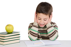Adorable child studying with books and apple Stock Photography