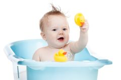 Adorable child taking bath in blue tub Royalty Free Stock Photos