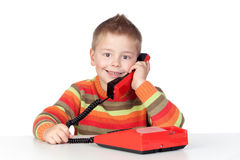 Adorable child with a tradicional telephone Royalty Free Stock Photo