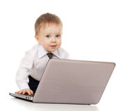 Adorable Child using a laptop. Funny child using a laptop Royalty Free Stock Image