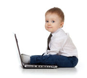 Adorable child using a laptop. Baby boy using a laptop Stock Image