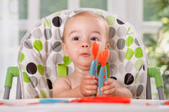 Adorable child waiting more food Royalty Free Stock Images