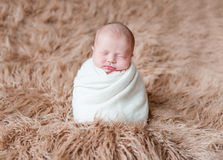 Adorable child in a white hat, sleeping Royalty Free Stock Image