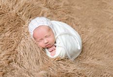 Adorable child in a white hat, sleeping Royalty Free Stock Photography