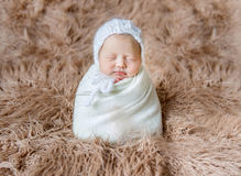 Adorable child in a white hat, sleeping Royalty Free Stock Images