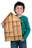 Adorable child with wooden house Stock Image