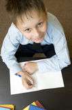 Adorable child writing. Royalty Free Stock Photography
