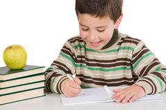 Adorable child writing in the school. On a over white background Stock Photo