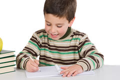 Adorable child writing in the school Stock Photos