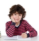 Adorable child writing in the school Stock Images