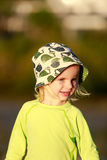 Adorable child in yellow shirt on the beach. Coromandel, NZ Royalty Free Stock Images