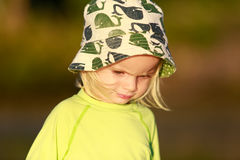 Adorable child in yellow shirt on the beach. Coromandel, NZ Royalty Free Stock Photos