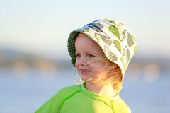 Adorable child in yellow shirt on the beach. Coromandel, NZ Royalty Free Stock Photography