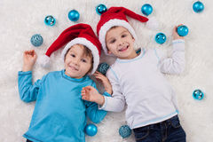 Adorable children, boy brothers, playing with christmas decorati Royalty Free Stock Images