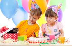 Adorable children celebrating birthday party and opening gift bo Royalty Free Stock Photo