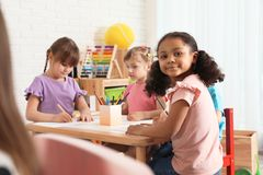 Free Adorable Children Drawing Together At Table. Kindergarten Playtime Activities Stock Photo - 147164080