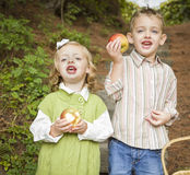 Adorable Children Eating Red Apples Outside Royalty Free Stock Photo