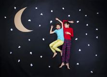 Adorable children getting ready for night sleep Stock Photos