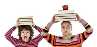 Adorable children with many books royalty free stock image