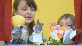 Adorable children playing with hand toys on puppet show stock footage