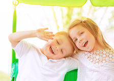 Adorable children on swing Stock Photo