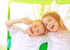 Adorable children on swing Stock Photo