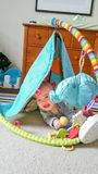 Adorable Chinese Caucasian Baby Boy Playing On The Floor. Adorable Chinese and Caucasian Baby Boy Playing with Toys On The Floor Stock Image