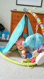 Adorable Chinese and Caucasian Baby Boy Playing On The Floor. Adorable Chinese and Caucasian Baby Boy Playing With Toys On The Floor Royalty Free Stock Photos