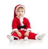 Adorable Christmas baby in Santa's clothes stock photos