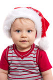 Adorable christmas child in a red hat Stock Image