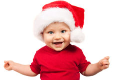 Adorable christmas child in a red hat Royalty Free Stock Photos