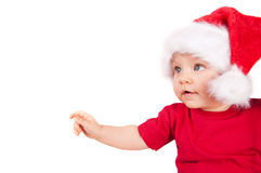 Adorable christmas child in a red hat Stock Photos