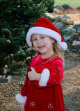 Adorable christmas girl in santa hat Stock Photo