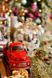 Adorable christmas red car toy with santa and presents. Musical miniature decoration on tree bokeh background Stock Photo